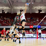 Kaitlyn Kearney attacking the ball in NC State's win over SMU inside the newly renovated Reynolds Coliseum.