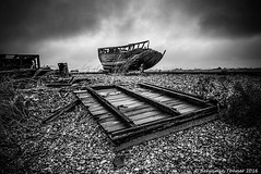 I left my heart in Dungeness (frattonparker) Tags: nikond600 tamron28300mm raw lightroom6 frattonparker btonner dungeness wreck wrecked boatwreck boats shed shingle planks clinker carvel clouds sky overcast rain timbers gunnels gunwhales hull hulk seacabbage grass hut