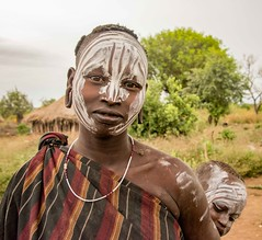 Mursi Woman, Ethiopia (Rod Waddington) Tags: africa african afrika afrique ethiopia ethiopian ethnic etiopia ethnicity ethiopie etiopian thiopien omovalley omo outdoor omoriver valley village valle villager mursi tribe traditional tribal woman culture cultural child portrait