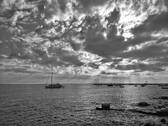 anchoring at the rocky coast (www.toprq.com/iphone) Tags: 500px sailing boat water sea sunset ocean sky beach travel clouds sun summer seascape rocks waves coast croatia pag novalja anchoring rocky rays black white