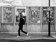 Northern Quarter #134 (Peter.Bartlett) Tags: manchester bag niksilverefex unitedkingdom people facade olympuspenf noiretblanc lunaphoto walking candid city peterbartlett man urban m43 monochrome uk poster microfourthirds sign bw urbanarte wall blackandwhite streetphotography fence