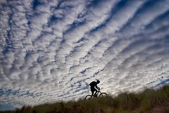 Out for a ride. (bainebiker) Tags: mackerelsky clouds mountainbike cyclist sanddunes canonef24mmf14liiusm silhouette ynyslas ceridigion uk