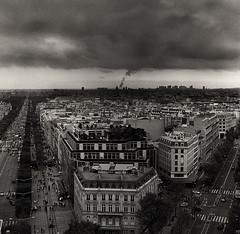 Nos rves lointains... (Zeb Andrews) Tags: city travel urban paris france film clouds square europe moody gloomy gray overcast hasselblad avenue wondering arcdetriomphe bluemooncamera thecityofdreams 284stepslater