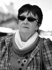 Shady Lady (Public Places) Tags: street portrait bw white black sunglasses lady pen blackwhite necklace noiretblanc candid streetphotography olympus jewelry shades jewellery f18 greatyarmouth 45mm ep3 publicplaces flickraward publicplacesportfolio