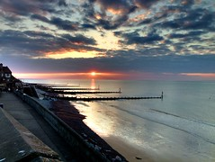 Weekend in North Norfolk (Neal Dench) Tags: sunset sea sun reflection clouds coast day waves cloudy shoreline shore groyne