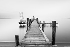 Lake Michigan Dock (John A. Gessner Photography) Tags: longexposure blackandwhite bw lake beach water weather fog landscape bay boat dock waves michigan jetty le shore traversecity grandtraverse