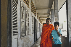 A young boy accompanied by a Buddhist monk at the Toul Sleng, S21, Cambodia (Chuongy) Tags: boy rouge cambodia khmer massacre buddhist phnom penh toul sleng
