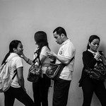Manila, Mega Mall Staff checking missied calls and messages on their cell phones as soon as their shift ends.......