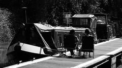 summertime and the living is easy (byronv2) Tags: summer blackandwhite bw sun monochrome scotland boat canal blackwhite edinburgh deckchair candid seat wharf boating harrisonpark barge unioncanal
