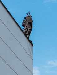 Is he meditating or waiting for the jump? (The Adventurous Eye) Tags: roof rooftop top lookout samurai