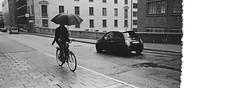 rainy day (doistrakh) Tags: travel blackandwhite bw panorama film monochrome bicycle 35mm europe rainyday kodak snapshot streetphotography rangefinder fujifilm nordic 135 rf malmskillnadsgatan doublex cinefilm nordiccountry  tx1   eastmandoublex5222 superebc 45mmf4 superebcfujinon cineflim