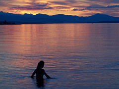 Water sprite at sunset (peter.a.klein (Boulanger-Croissant)) Tags: light sunset sky woman mountains reflection water girl rose clouds bay glow sprite pilings float