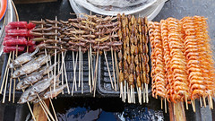 Snack stall, Dali (Niall Corbet) Tags: china food dragonfly shrimp snack grasshopper locust yunnan dali streetfood