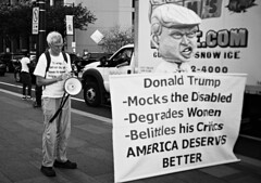 DR8-021-9 (David Swift Photography Thanks for 18 million view) Tags: davidswiftphotography philadelphia protest donaldtrump effigy politicalprotest demonstration 35mm film streetphotography yashicat4 ilfordxp2 politicalsigns banners
