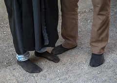 An iranian shiite couple walks in stocking feet during the chehel manbar ceremony a day before ashura, Lorestan province, Khorramabad, Iran (Eric Lafforgue) Tags: 2people ashura celebration ceremony chehelmanbar clothing colorimage commemoration couple covered hidden horizontal hussain imamhussein iran islam khorramabad man memorialevent middleeast mourner mourners mourning muharram muslim mysterious mystery niqab outdoors people persia religious ritual shia shiism shiite socks tasoua tasua tradition twopeople unrecognizableperson wife woman lorestanprovince ir