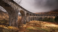 Underneath the arches (Einir Wyn) Tags: viaduct scotland scottishhighlands mist weather sky light outdoor train britain uk nikon nature natural tree glenfinnan bridge stone structure old industry