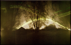 October Arches (batuda) Tags: pinhole obscura stenope lochkamera analog analogue can beercan cylindrical paper kodak polymax 18x16 mediumformat solargraphy solarigraphy solarigrafia solargraph sun solar sunpath arches tracks undeveloped unfixed tree trees mapple sky reflection reflections house building architecture ground autumn fall october šinkūnai tauragnai utena lithuania lietuva color colour epson 4490photo landscape