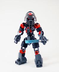 12 Days - Skyrise Fifteen (0nuku) Tags: bionicle lego matoran iron huna grey orange