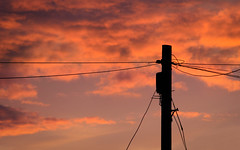 The light pole (sagesolar) Tags: sunset red orange silhouette clouds evening day power cloudy pole cables wires telegraph mygearandme mygearandmepremium