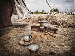 Empty Pots and Pans (Kamran H Khan) Tags: wood food sand flood empty ground olympus tent pots stove ii starvation famine pans starve 1454mm f2835 e620
