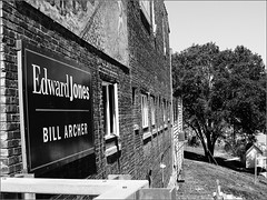 Edward Jones (joeldinda) Tags: bw building tree sign wall michigan grandledge joeldinda c50 windwos