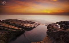 After a Haze Phenomenon (Ahmad Fahmi (markthedg)) Tags: red orange beach water rock stone sunrise photography nikon filter lee malaysia production kuala moment ahmad terengganu dgn abang fahmi d700