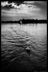 Sun beams (Joni Kantonen) Tags: street light bw sun sunlight public water river landscape boat beam beams kokemenjoki