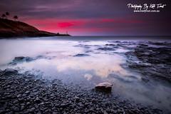 Kauai (Kiall Frost) Tags: longexposure red white black color colour sunrise photography hawaii photo rocks image smooth pebbles le kauai lihue kiallfrost