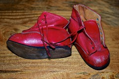 My First Shoes. (proutydwarf) Tags: red leather shoes boots nail scratches knot stitching heel sole laces orthopaedic scuffs orthotic