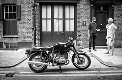 The deal (shotsnapz) Tags: street windows london film lines tarmac doors pavement bricks nine 7 9 olympus number motorbike seven shoreditch barefoot deal bmw motorcycle conversation gesture bricklane fp4 numberplate om4