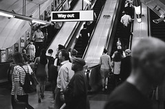 Way Out (RatBall) Tags: england bw white black london film analog train 35mm way out underground subway escalator olympus 400 fujifilm zuiko om1 xtra