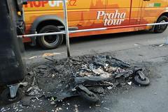 (rowibish) Tags: street orange tourism trash fire photography tour prague wheels praha bin burnt rubbish hopoff nikon1 nikonv1