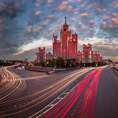 Kotelnicheskaya Embankment Building, One of the Moscow Seven Sisters in the Evening, Moscow, Russia (ansharphoto) Tags: road street city travel blue sky urban house building tower monument electric skyline architecture night facade skyscraper river landscape lights evening town high twilight europe cityscape view traffic symbol russia dusk moscow famous capital traces trails landmark illuminated steeple spire soviet streaks russian iconic embankment stalin ussr stalinist kotelnicheskaya kotelnicheskiy