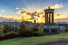 God Rays over Auld Reekie (MilesGrayPhotography (AnimalsBeforeHumans)) Tags: architecture auldreekie autumn britain balmoralclocktower balmoral canon 6d canon6d city cityscape castle 1635 canonef1635mmf4lisusm dugaldstewartmonument edinburgh eos ef europe evening edinburghcastle f4l caltonhill glow historic historicscotland iconic landscape lens monument outdoors old oldtown photography ruins scotland skyline sky sunset scenic sunshine sunlight godrays rays raysoflight town tower twilight uk unitedkingdom dusk volcano volcanic castlerock wide eu european