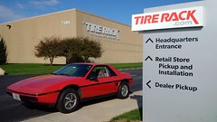 Two New Tires at Tire Rack (artistmac) Tags: southbend in indiana tirerack tires wheels parkinglot haha rotors calipers car outdoor pontiac fiero midengine sportscar red redcar pcar gm generalmotors morning hitechturbo alloywheels