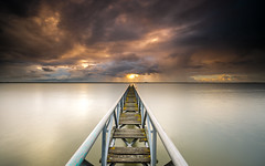 From her to eternity (marcolemos71) Tags: seascape river tagusriver water wood oldpier steel sunrise sun sky clouds rain vanishingpoint tranquility longexposure