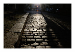 curb, cobbles and a walking giant (rainbowcave) Tags: cobbles street shadow sun curb strase sonnig schatten bordstein kopfsteinpflaster autumn fall herbst
