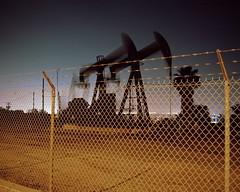 Pump jacks (ADMurr) Tags: la southla fence oil gas pump jacks mamiya 7 80mm night kodak ektar