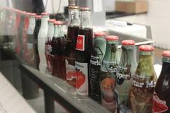 Coke bottles. (aphouuuu) Tags: bottles coke cocacola cokebottles worldofcocacola sodabottles