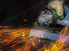grinding in a steel factory (anekphoto) Tags: light men industry wheel metal work fire person construction iron industrial factory technology hand power mask tech employment cut steel welding labor flash craft structure safety equipment flame repair technical heat production worker manual protective craftsman job spark protection grinder tool grinding fabricate skill manufacture occupation welder manufacturing