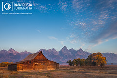 T.A. Moulton barn (Rafa Irusta) Tags: morning autumn sky usa mountains building fall nature clouds barn sunrise season landscape dawn nationalpark scenery scenic scene wyoming grandteton grandtetonnationalpark mormonrow grandtetonpark cathedralgroup rafairusta rafairustacom