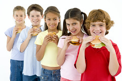 Row of five young friends eating hamburgers (Dakota Local) Tags: friends boy portrait people food girl smile smiling horizontal kids female youth standing cutout studio children happy stand child buddies friendship eating burger group whitebackground together hamburger meal junkfood studioshot takeaway diet mates enjoying halflength girlfriends hangingout unhealthy younggirl havingfun caucasian youngboy fivepeople