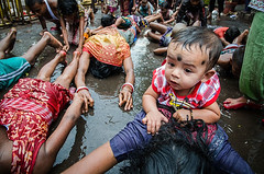 Dondi, A ritual (SaumalyaGhosh.com) Tags: street people baby india color nikon child streetphotography ritual lying hindu kolkata dondi 1685 d7000 dondikata