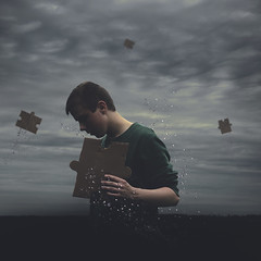 Solving the puzzle of life. (Albin Thelander) Tags: art water clouds dark photography nikon underwater pieces sad fine surreal levitation overcast bubbles puzzle concept emotional conceptual piece dull carboard d7000