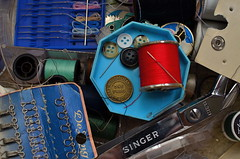 Oh, wait, that's not a button... (MPnormaleye) Tags: urban stilllife detail closeup bronze composition 35mm subway design decorative scissors utata button token brass arrangement bizarre whimsical utata:project=ip183