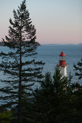 West Vancouver Lighthouse (adrianmojica) Tags: ocean park trip travel blue trees light sunset red sea vacation sky lighthouse mountain canada mountains color tree green nature water vertical vancouver canon landscape island photography eos islands coast photo colorful day bc photos hiking britishcolumbia horizon sunsets canadian hike telephoto 5d coastline depth vancouverbc westvancouver lighthousepark atmosphericperspective blamecanada sunsetporn canoneos5dmarkii sunsetlovers 5dmarkii 5dmkii canon5dmarkiii canonef70200mmf28lisiiusm