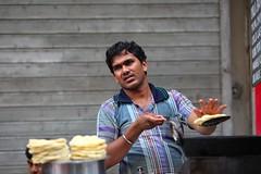 Just fried poori or puri on the streets of Kolkata (Ferdousi.) Tags: india candid streetphotography traveling streetfood kolkata takingphotos poorionthestreetofkolkata