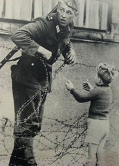 #An East German soldier helps a young boy cross the barbed wire which was a marker for where the Berlin wall would soon be built. The guard was caught and immediately punished on August 15, 1961 [1148 x 1600] #history #retro #vintage #dh #HistoryPorn http (Histolines) Tags: histolines history timeline retro vinatage an east german soldier helps young boy cross barbed wire which was marker for where berlin wall would soon be built the guard caught immediately punished august 15 1961 1148 x 1600 vintage dh historyporn httpifttt2fe32ww