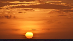 At sunset (cernicb) Tags: sun sunset sky clouds sea horizon evening waves red orange