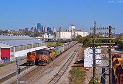 """BNSF and UP Trains in Kansas City, KS (""""Righteous"""" Grant G.) Tags: up union pacific railroad railway locomotive train trains sp espee patch ge emd power kansas city grain manifest freight"""